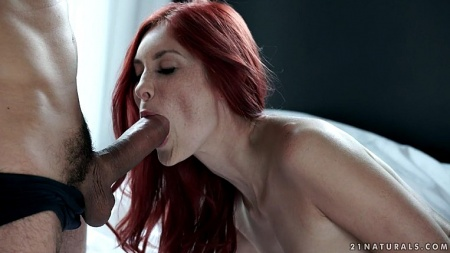 Redhead girl with freckles has sperm in mouth